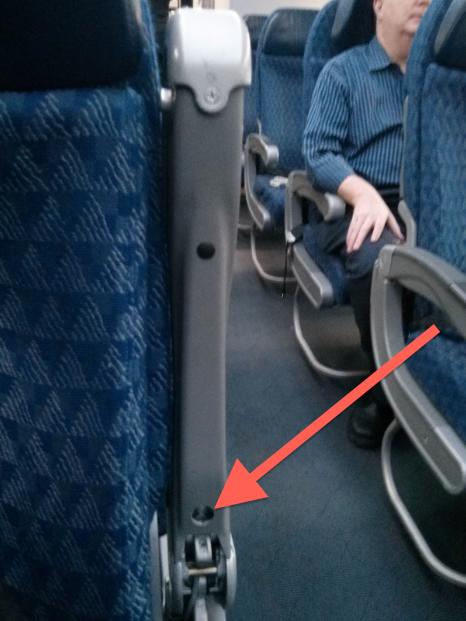 hidden-armrest-button.png